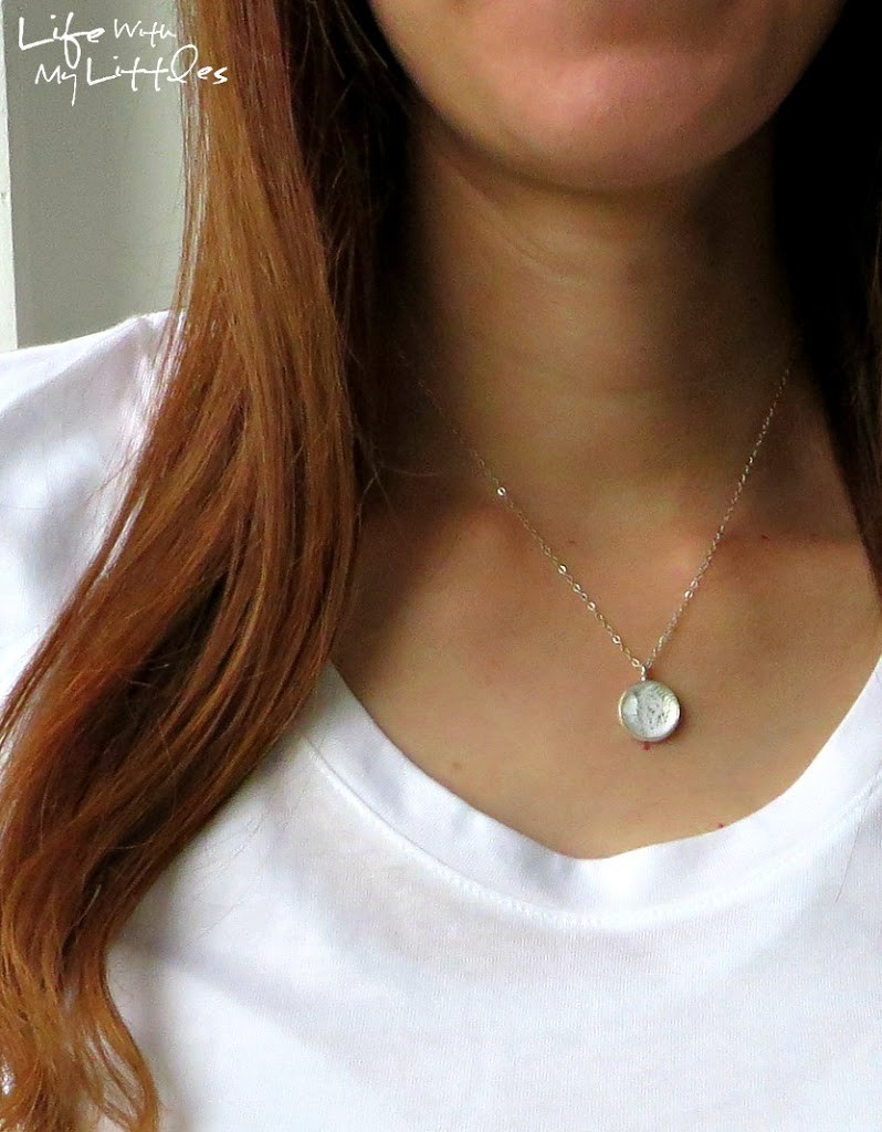 DIY wedding dress necklace tutorial that shows you how to use a tiny piece of your wedding dress to make a quick and easy pendant. Looks gorgeous and a great thing to do with your dress after the wedding!