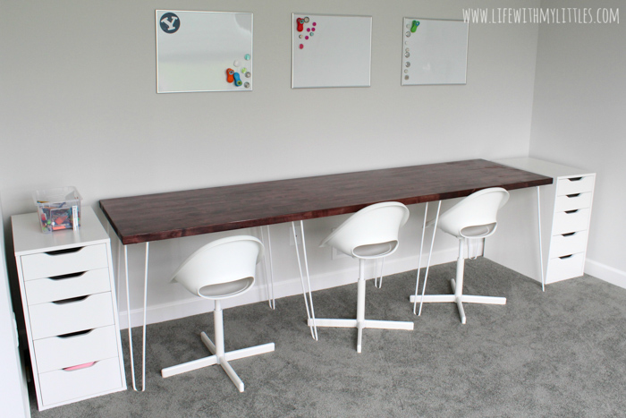 A simple, minimalist DIY triple desk tutorial that even the most beginning of DIYers can tackle! The butcher block countertop gives it a beautiful farmhouse feel and it's perfect for any homework or homeschool room!
